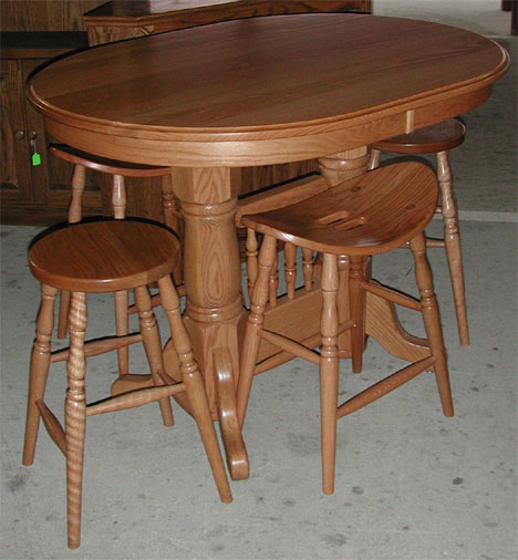 Amish solid oak double pedestal bar table, plus solid oak and cherry barstools.