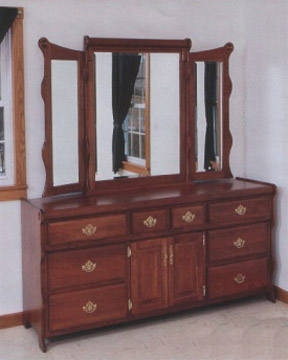Solid cherry sleigh style dresser made by the Amish
