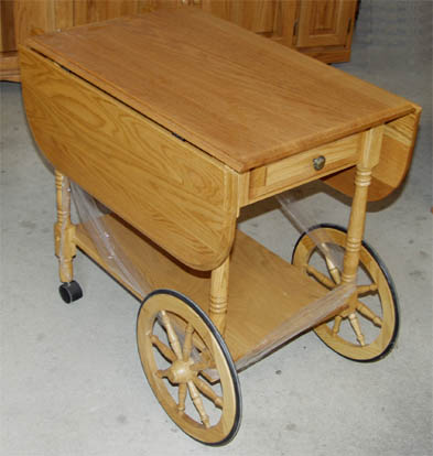 Solid oak drop-leaf tea cart with a drawer, made by the Amish