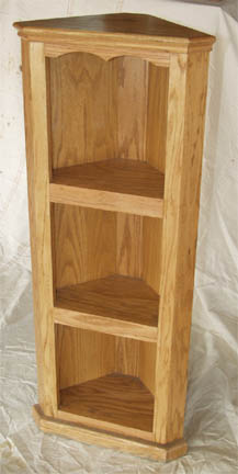 Solid oak corner shelf goes anywhere in your home. Amish made.
