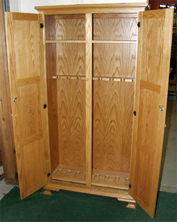 Inside view of our Amish made solid oak gun cabinet