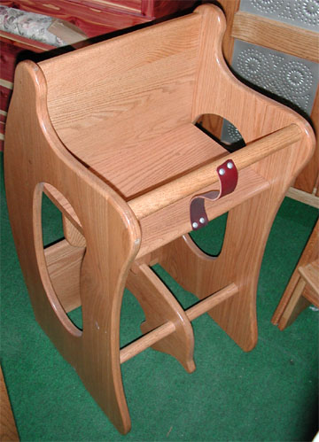 soild oak 3 in 1 chair made by the amish features high chair, study desk and rocking horse