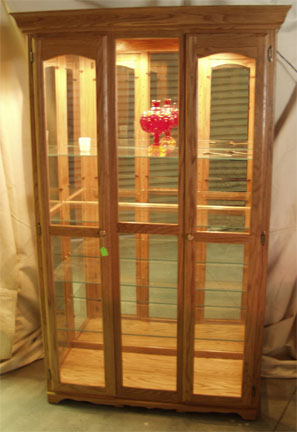 amish crafted solid oak mirror back glass display cabinet with light on